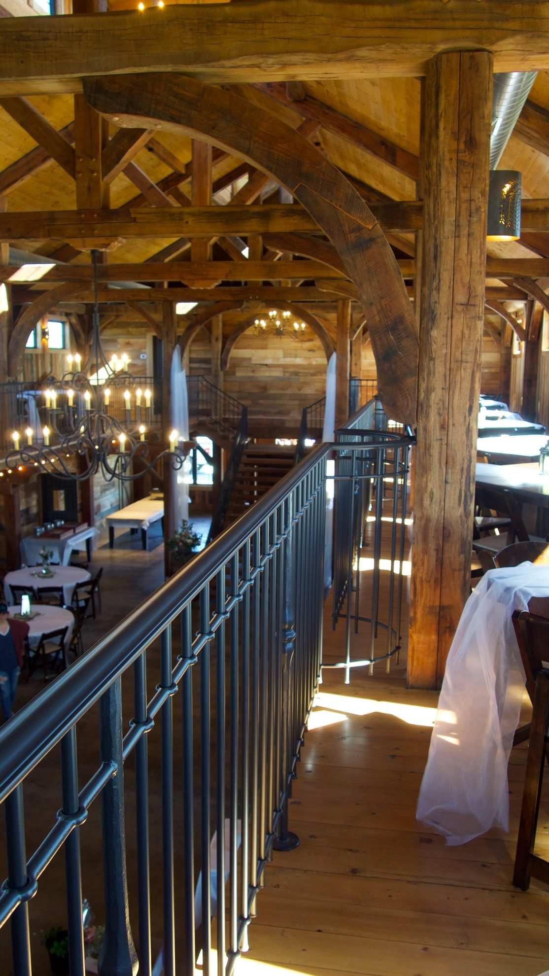 Photo of wedding barn looking down from a balcony.